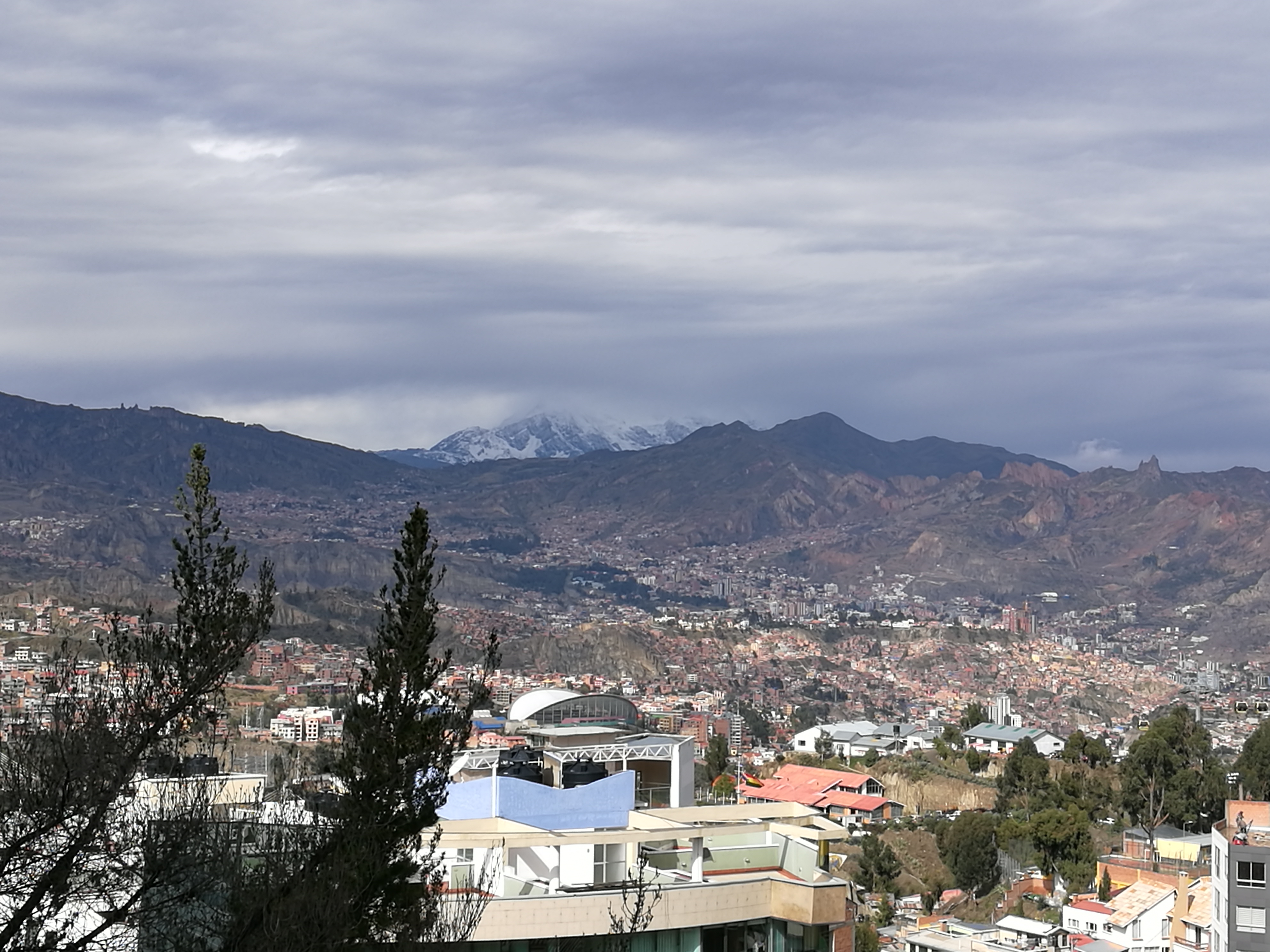 Scenes from the capital city, La Paz, Bolivia, as winter settles in on the city's trees and, surrounding mountains.