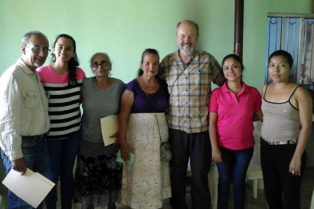 Julio (far left) and Brian visiting one of the microloan groups.