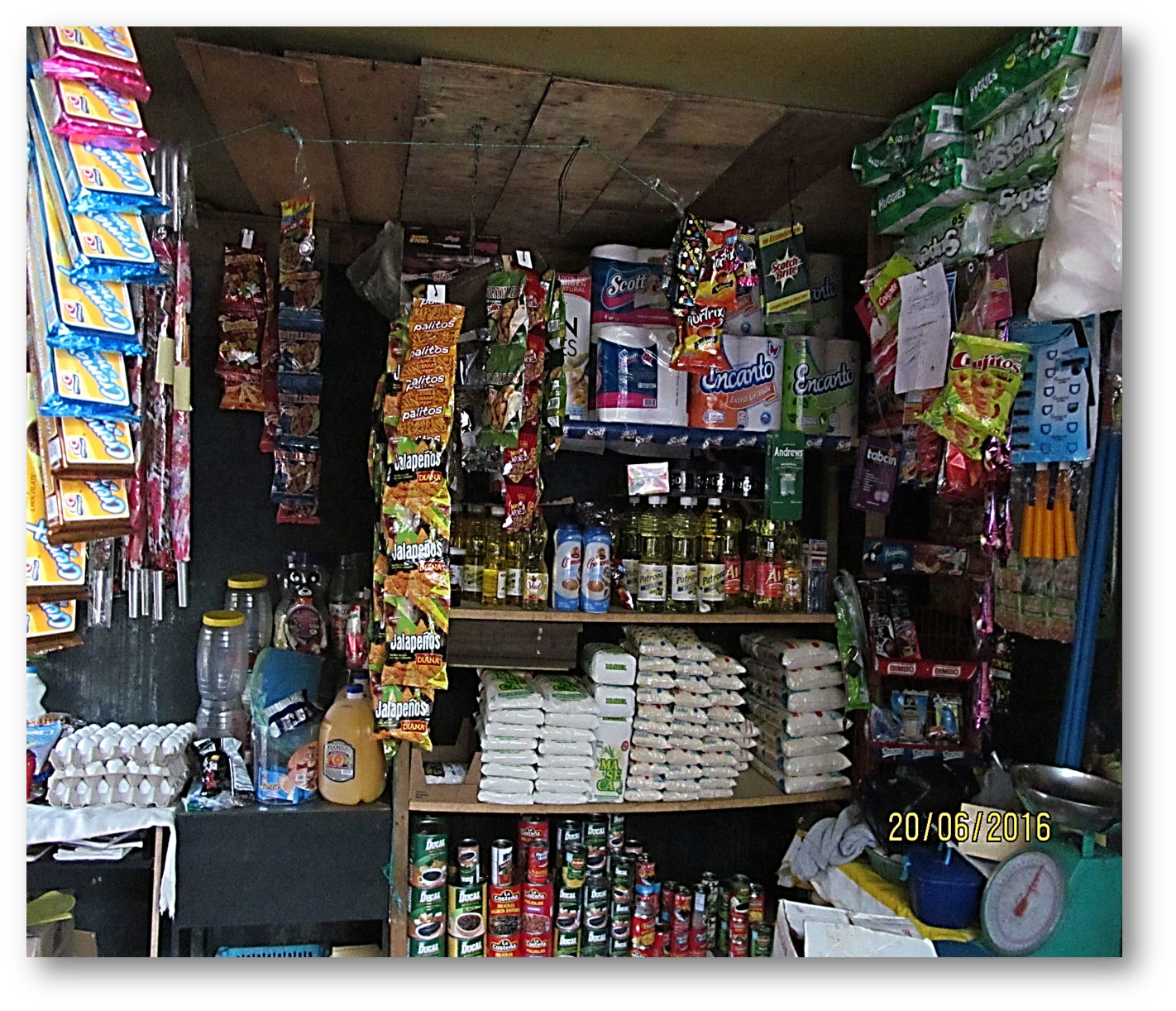 Marcia's store full of new goods from a microloan.