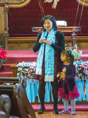 Theresa Cho, co-pastor of St. John's Presbyterian Church in San Francisco, leads worship with her daughter, Isabella Kim. (Photo provided)