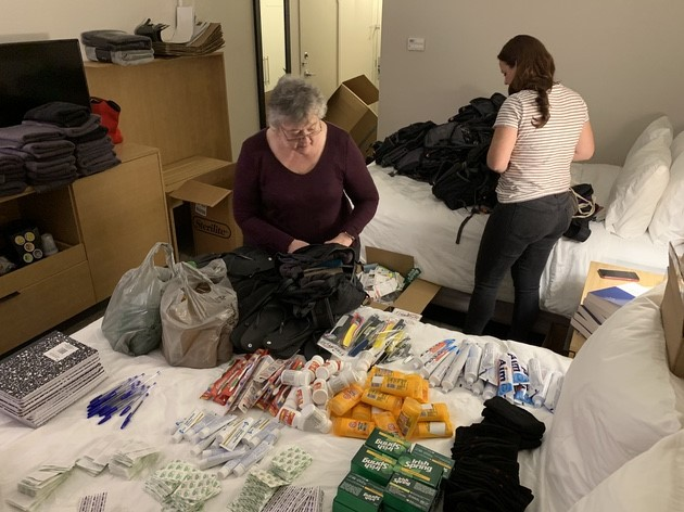 Prepping health kits for migrants at the border.