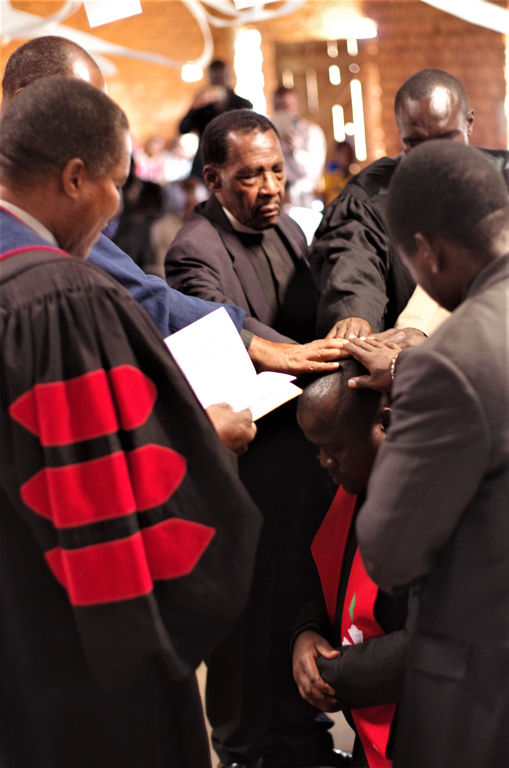 Ministers of the Church of Central Africa Presbyterian, Synod of Livingstonia install their colleague Reverend Thandwayo Banda.