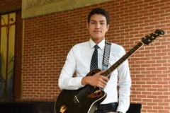 Caleb Chincoya with his guitar after undergraduate chapel at the University of Dubuque. —Nicky Story