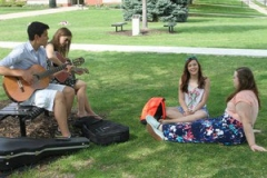 Caleb Chincoya sings with fellow students on the University of Dubuque quad. —Daniel T. Gashangi