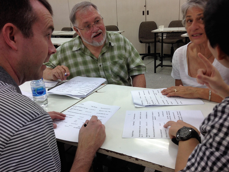 Volunteers and Thai teachers work on curriculum together