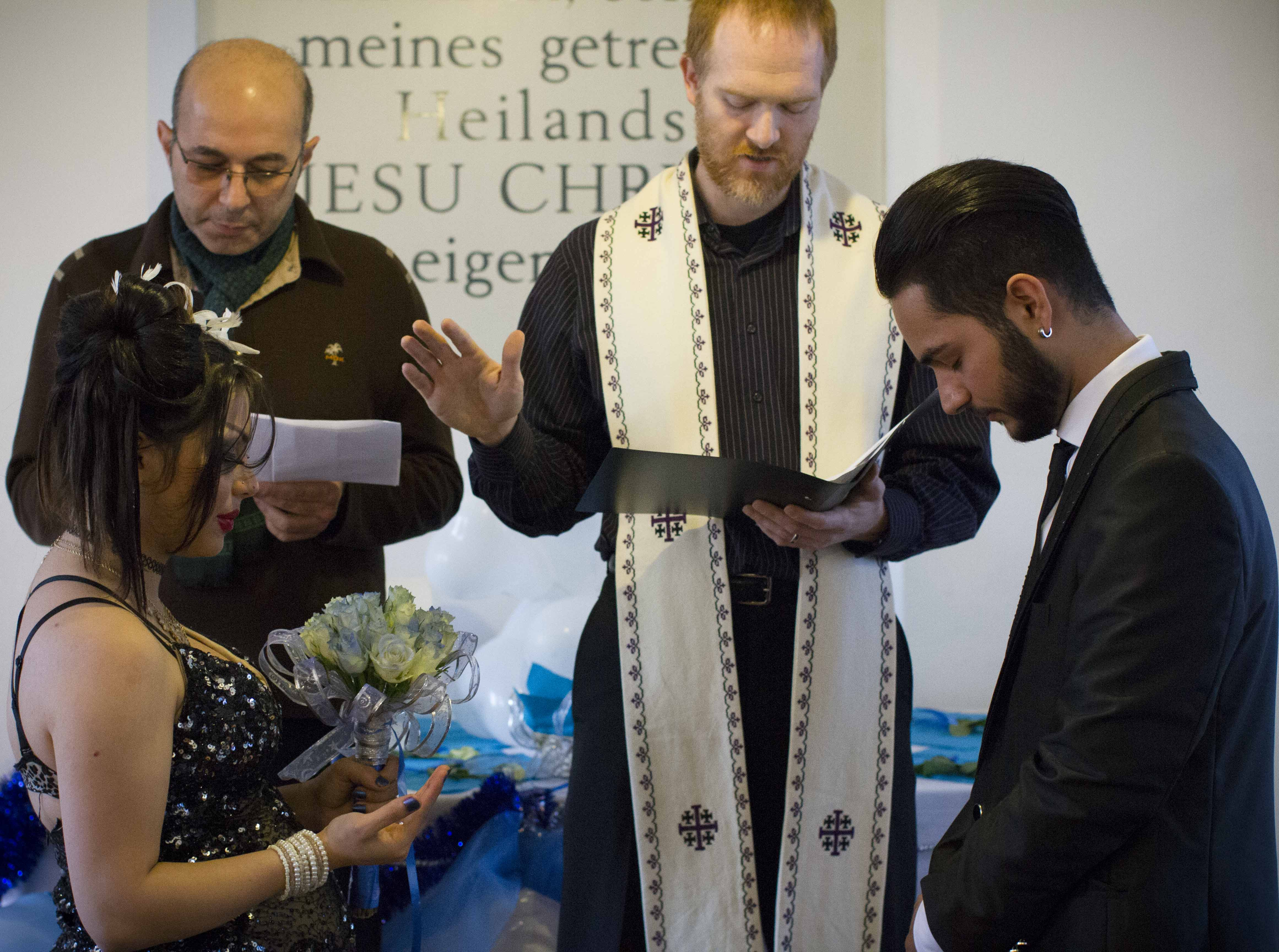 Ryan offering a prayer for the couple during one of the recent weddings