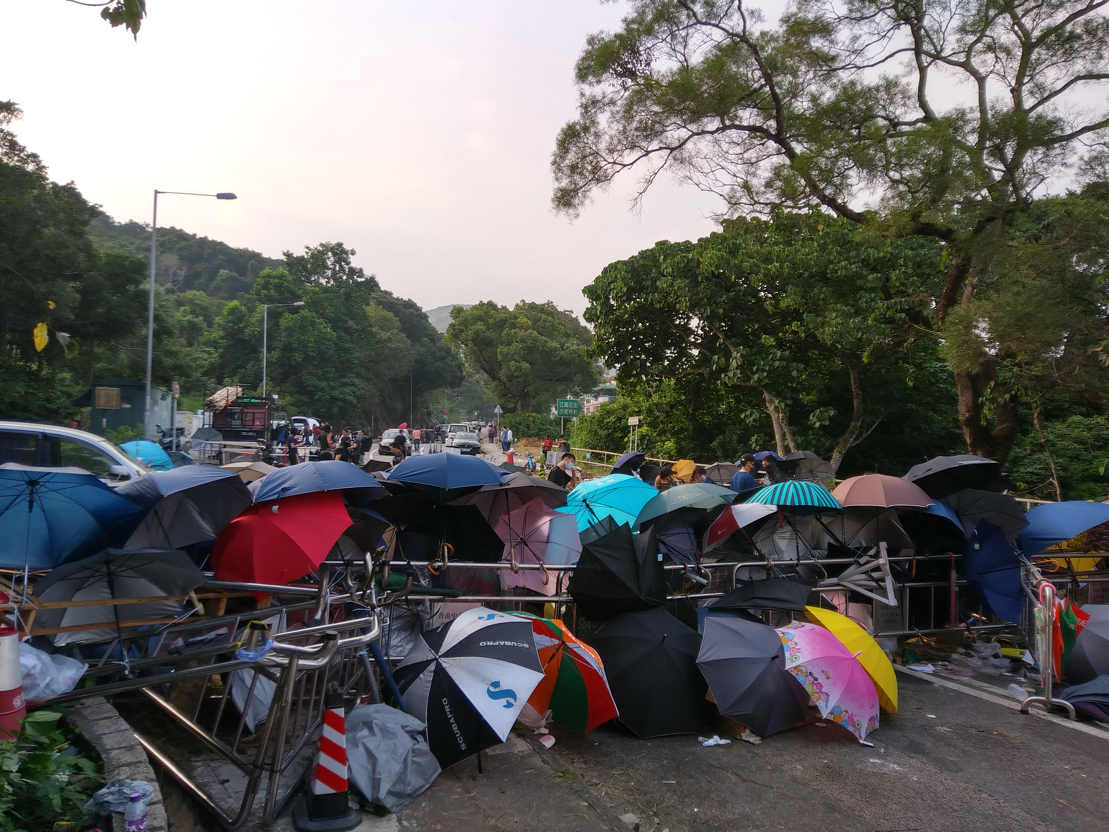 An umbrella barricade blocked the road to the school.