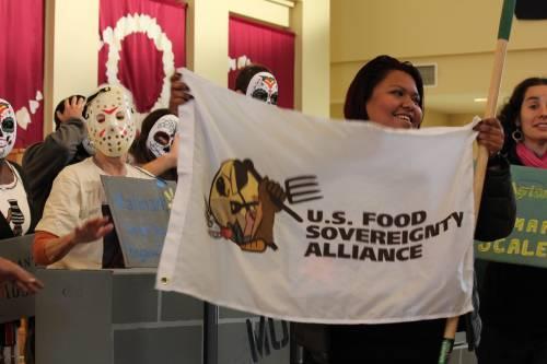 Farmworker holds up UFSFA flag