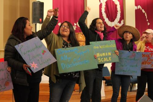 women celebrate the victory of farmers, farmworkers and allies