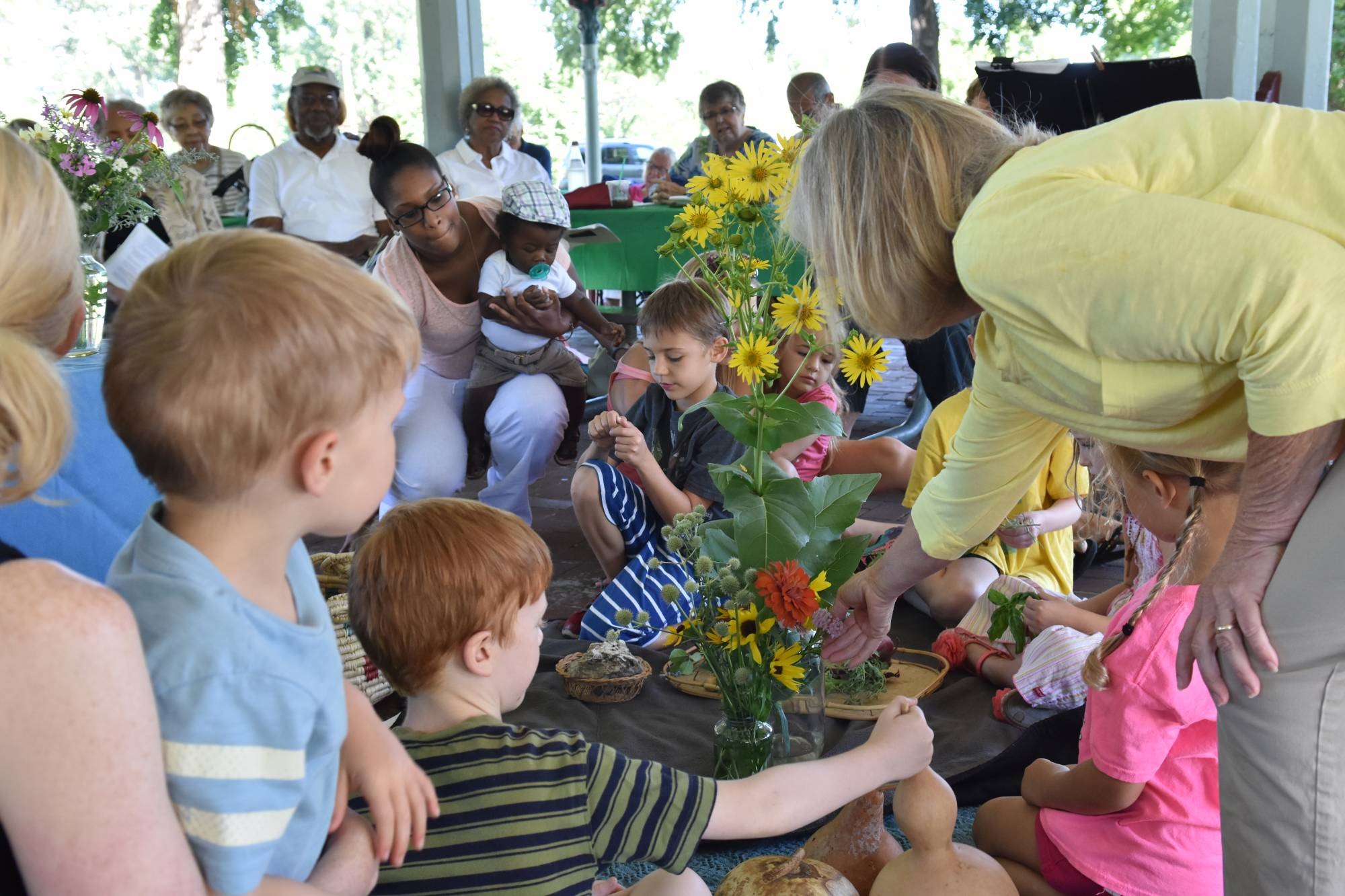 kids and adults with flowers in a worship service
