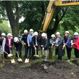 folks with shovels breaking ground for the new affordable units