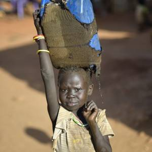 Boy carrying clothes