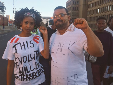 woman and man, woman's shirt says This revolution will be intersectional