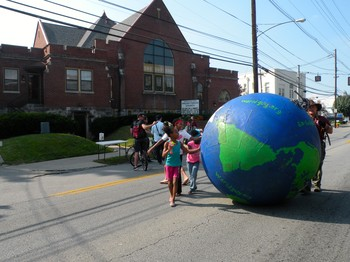 Bardstown Road Presbyterian Church (Louisville, KY) with children and big globe out front in street