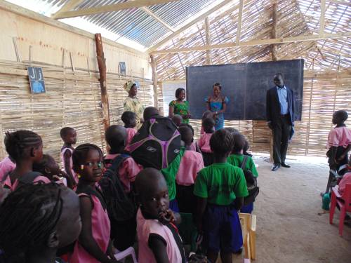 The Director of Education for the Presbyterian Church of South Sudan visiting a local classroom
