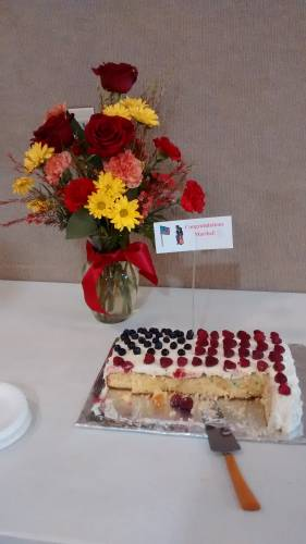 Corydon Presbyterian Church presented Maribel with this bouquet and cake to celebrate her naturalization as a U.S. citizen