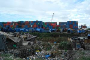 Stacks of shipping containers in the Philippines that companies park near landfill sites. —Frank Dimmock