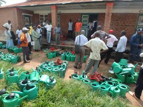 Community health workers receiving gardening tools