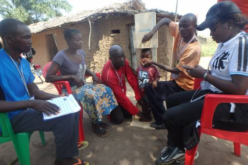 One of the nutrition survey teams interviewing a family and taking anthropometric measurements of the children under 5 years of age in the household. The data was entered into a survey form loaded on smart phones using ODK (open data kit).