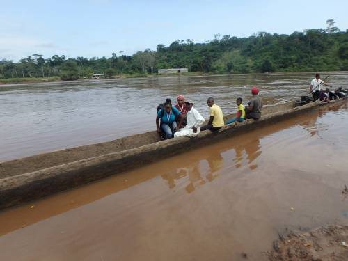 A nutrition team crosses one of the many rivers in the health zones to reach a village for surveying