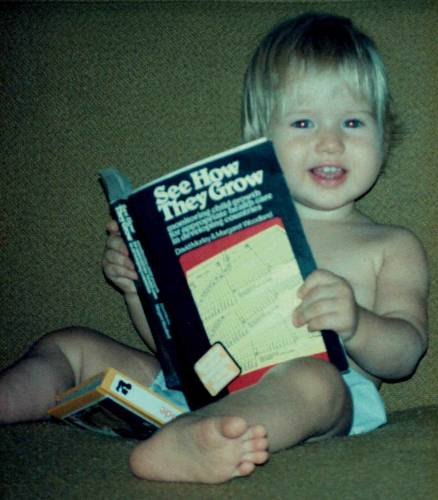 "Lisa ""reading"" her father's public health book"