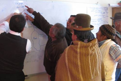 Communities mapping out the areas affected by mining contamination during a workshop facilitated by Dr. Fernando Serrano (Professor at St Louis University) in Oruro, Bolivia