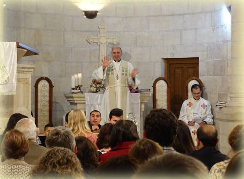 Rev. Mitri Raheb greets the congregation on Easter Sunday at Christmas Lutheran Church in Bethlehem