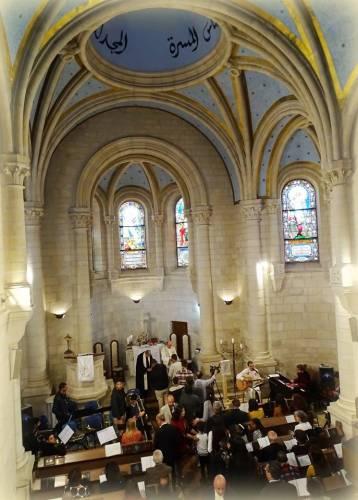 The congregation of Christmas Lutheran Church, Bethlehem, celebrates communion on Easter Sunday