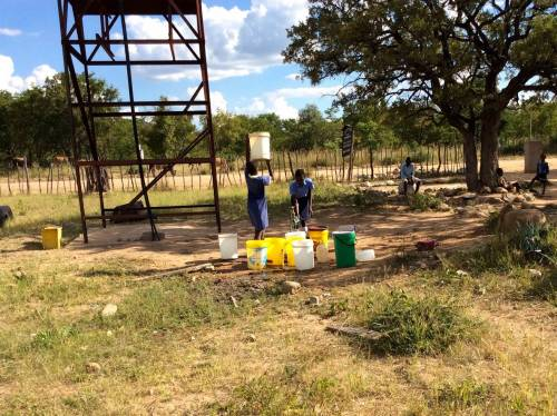 Students fetching water supplied by the solar borehole at Mnondu School