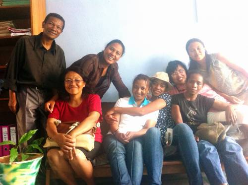 Pastor Helivao (third from right) and members of the SAFFIFAA staff with some of the women who they helped to return from Kuwait (seated on couch)