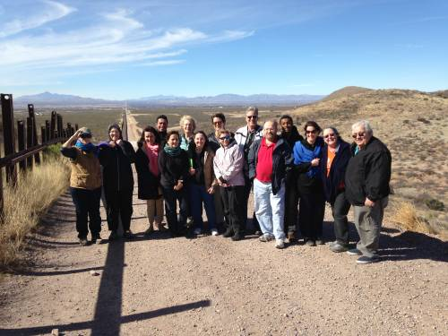 The Voices from the Border and Beyond group at the U.S. Border Patrol fence in Douglas, Arizona/Agua Prieta, Mexico