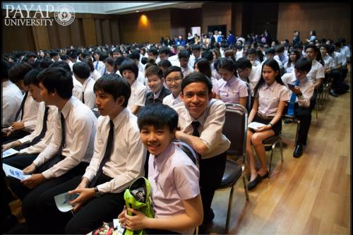 """Fourth-year students enjoy Baccalaureate. The young man leaning forward has a disability, but his name is """"Able"""" and he gave me a big hug when I pinned him with his Payap pin. I met him his first year and have enjoyed watching his progress through Payap."""