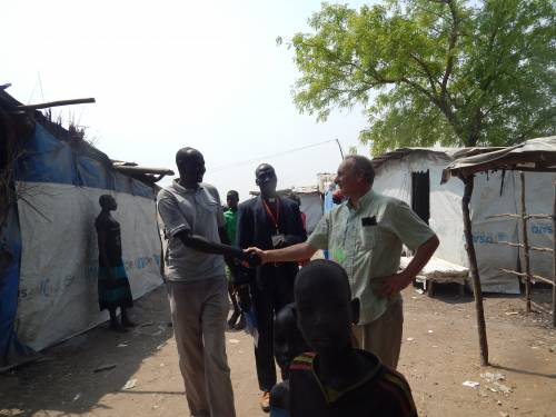 Michael greeting friends in South Sudan