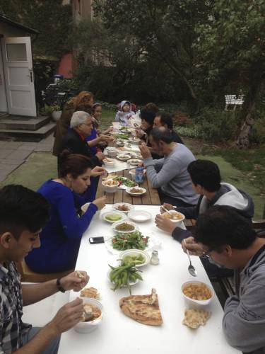 A community event of fellowship and traditional Iranian food Abgooshat.