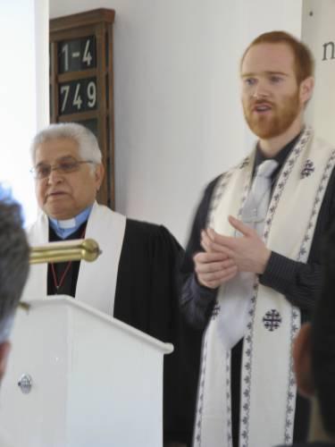 Ryan with Rev Sepheri preaching joint worship service with German congregation.