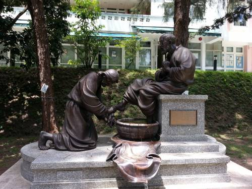 A Bronze sculpture of Jesus' washing of feet in front of our dormitory